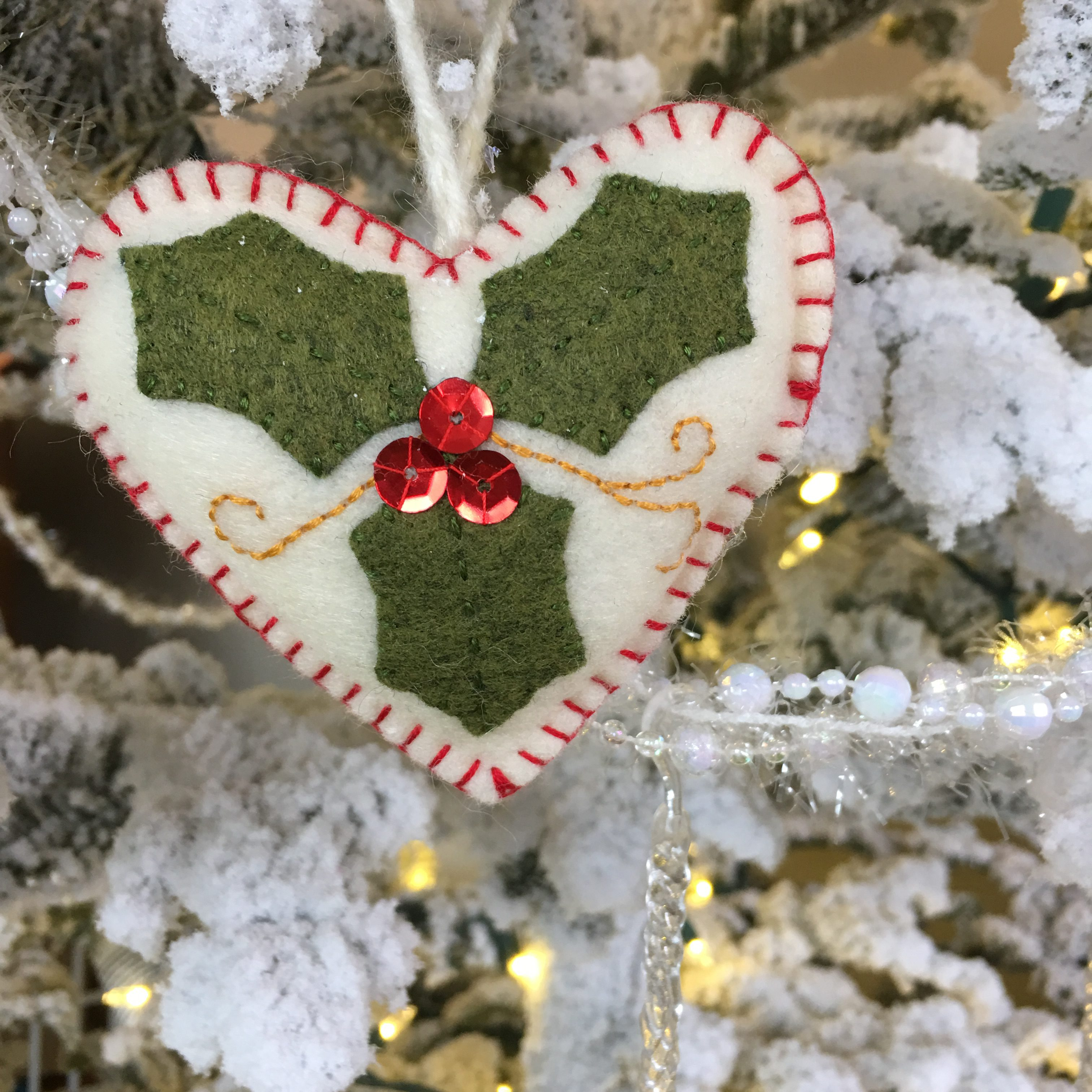 make some fun and easy ornaments for your tree this year with some simple supplies and basic skills you can stitch the leaves on the heart or glue them in